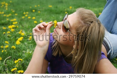 Girl and green meadow