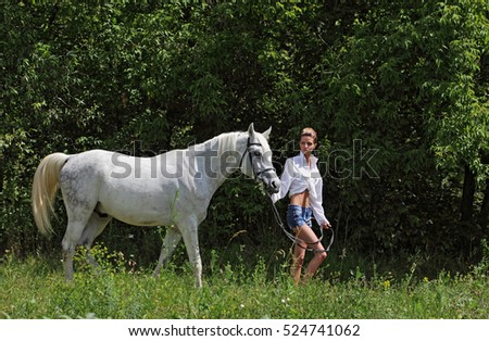 Girl and horse on the walk