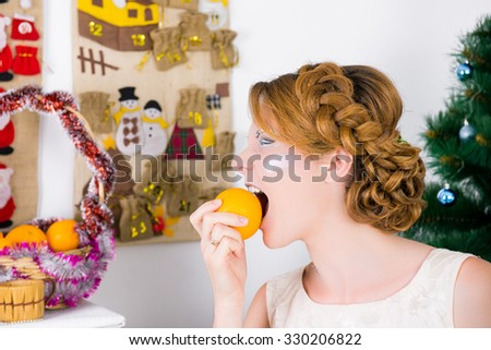 Girl and orange. Portrait of a young beautiful woman with orange. Christmas food, fruit for the Christmas menu, a diet before Christmas  - stock photo