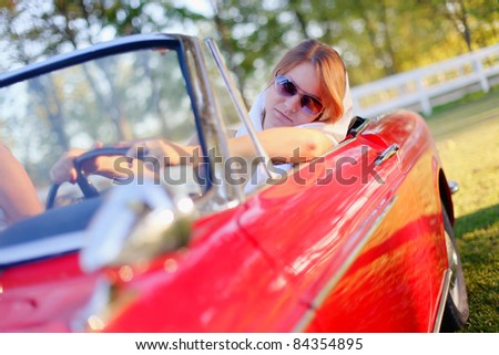 Girl and red cabriolet - stock photo