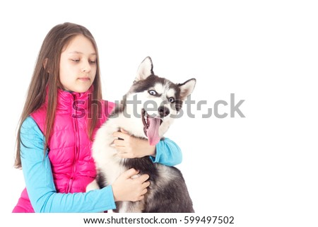 Girl and Siberian husky on white background