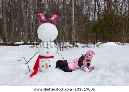 Girl and snowman - stock photo