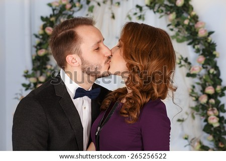 girl and the guy kiss.Young affectionate couple kissing.Young man kisses his beautiful girlfriend - stock photo