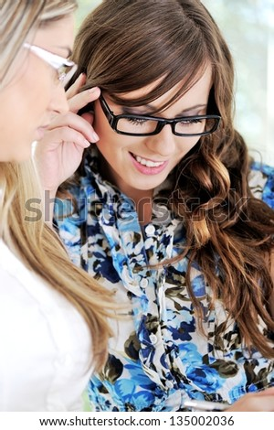 Girl And Woman Mentor Reading Together At A House - stock photo