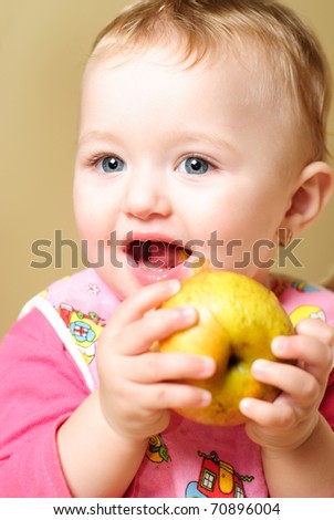 Girl are eating an apple and smiling - stock photo