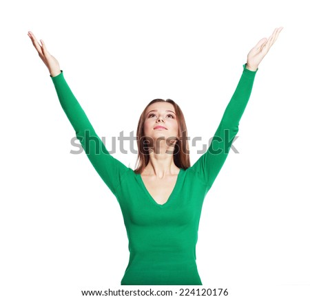 girl arms up, looking upwards like holding something above, full length standing isolated on white background.  - stock photo