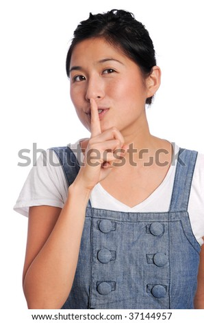 Girl asks someone to be quiet - stock photo