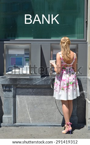 Girl at ATM - stock photo