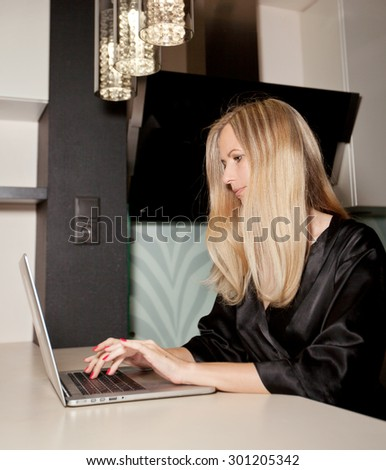 girl at home on the computer - stock photo