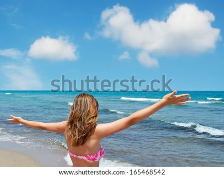 girl at the beach with open arms - stock photo