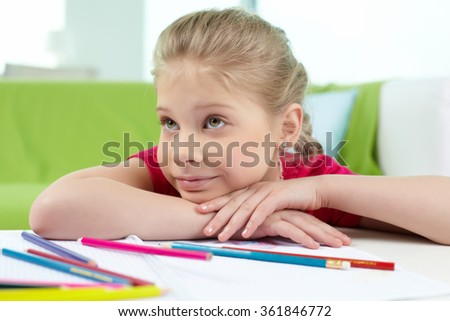 Girl at the desk - stock photo