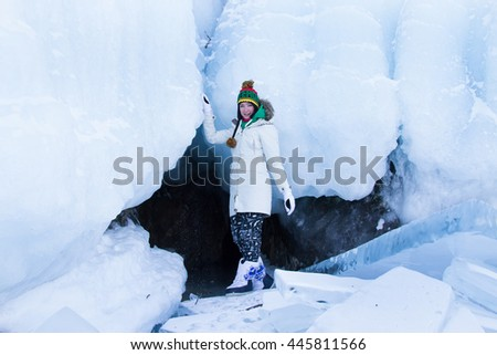 girl at the entrance to the ice cave