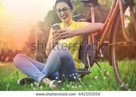 Girl at the park using her smartphone