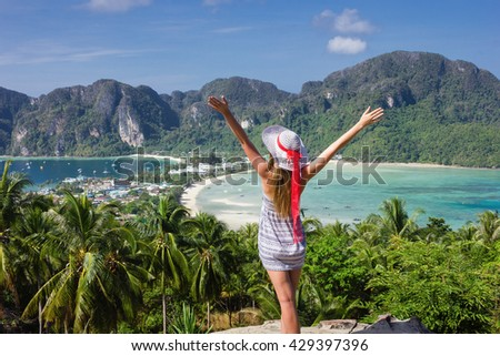 Girl at the resort in a dress on the background of the bays of the island of Phi Phi Don - stock photo