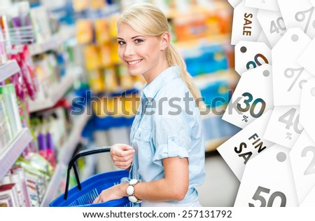 Girl at the shop choosing shampoo at a good price. Concept of consumerism, retail and purchase - stock photo