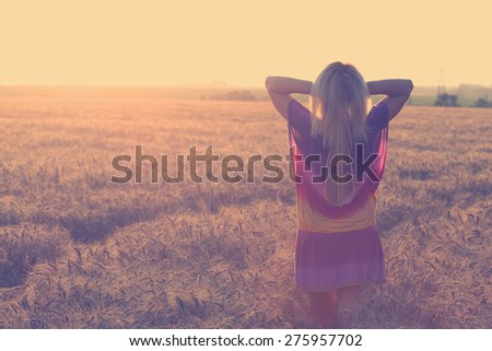 girl at the wheat field - stock photo