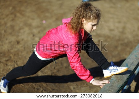 girl athlete gymnastics spring outside - stock photo