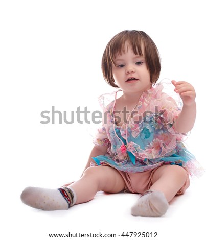 girl baby in a colorful dress isolated on white background - stock photo
