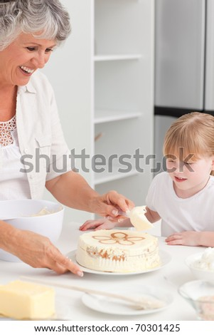 Girl baking with her grandmother at home