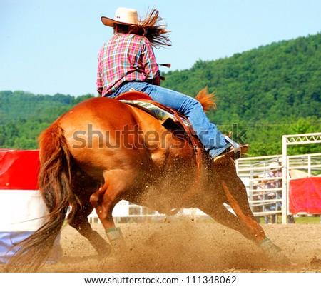 Girl barrel racing - stock photo