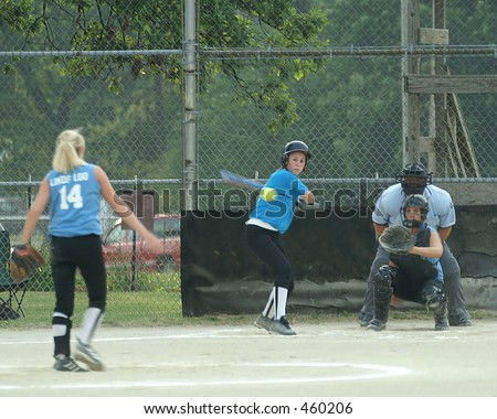 girl batting in softball game - stock photo