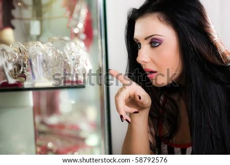Girl before showcase - stock photo