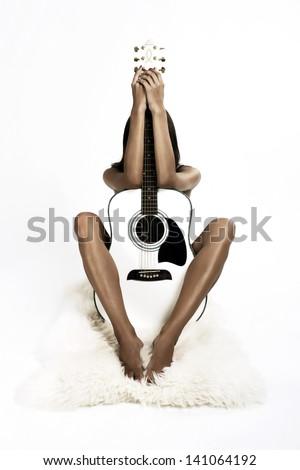 Girl behind a guitar - stock photo