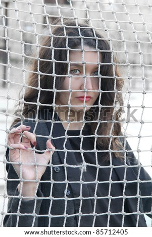 Girl behind the net - stock photo