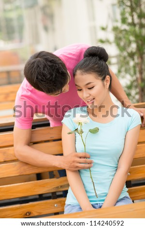 Girl being surprised with a lovely gift from her boyfriend - stock photo