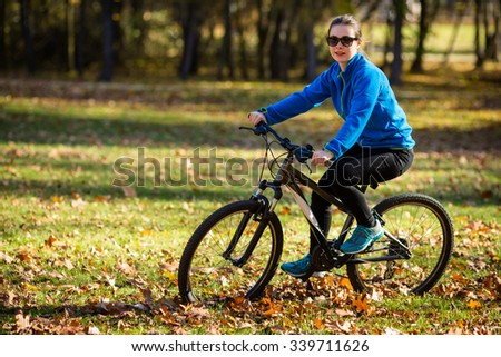 Girl biking in city park
