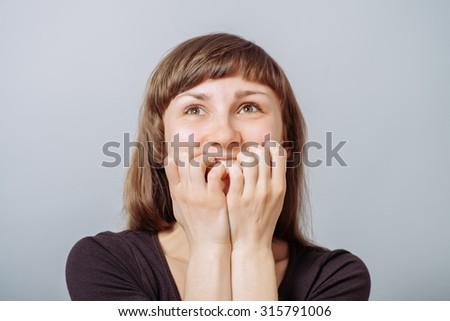 girl bites his nails - stock photo