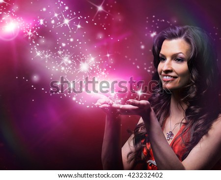 girl blowing magic stars