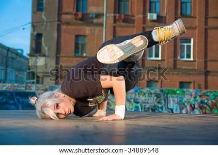 Girl break-dancer posing - stock photo