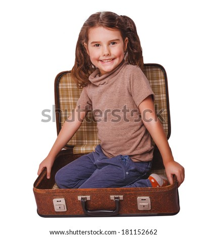 girl brunette baby sitting in a suitcase for travel isolated on white background - stock photo