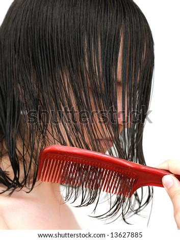 Girl brushing her wet hair - stock photo