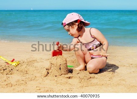 Girl building a sand castle on the beach