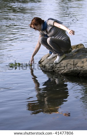 girl by the river - stock photo