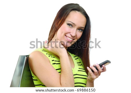 Girl calling by mobile phone with shopping bags. Isolated - stock photo