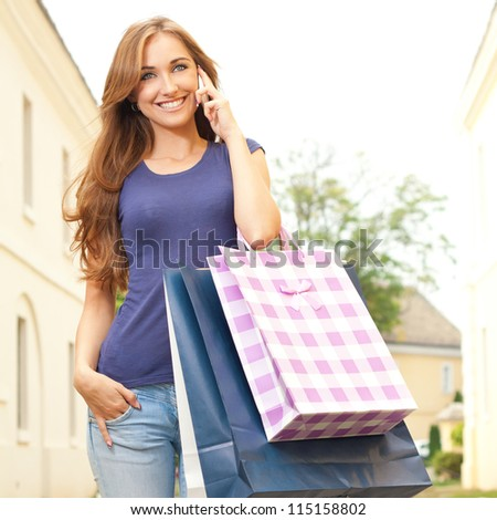 Girl calling someone after the purchase - stock photo