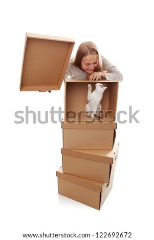 girl, cardboard boxes and a kitten on a white background - stock photo