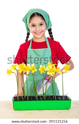 Girl care yellow daffodils on the table, isolated on white - stock photo