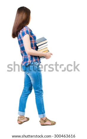 girl carries a heavy pile of books. side view. Rear view people collection. backside view person. young girl in checkered blue with red stripes stands sideways and holding a stack college textbooks. - stock photo