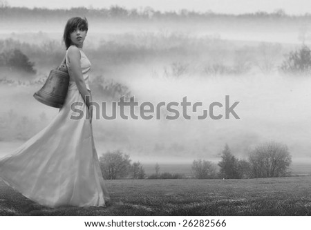 Girl carrying a bell - stock photo