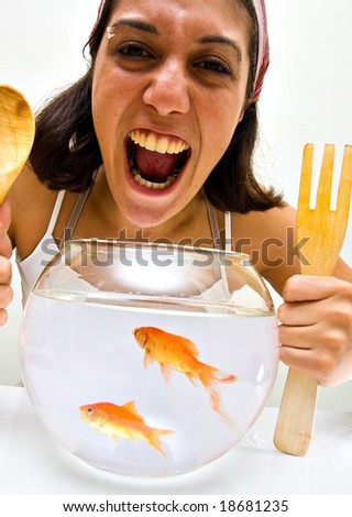 girl catching fish from a bawl