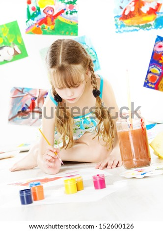 Girl child painting with color brush. Children creativity and drawing art concept.