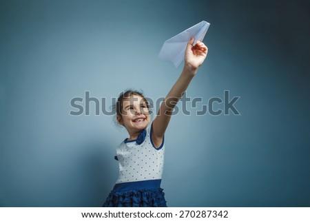 Girl Child Teen seven years, European appearance brunette holding - stock photo