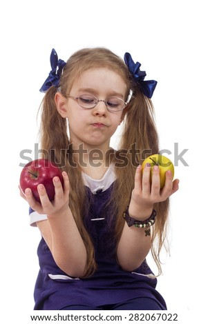 girl chooses apples isolated white background - stock photo
