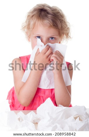 Girl cleaning  her nose with tissue isolated on white - stock photo