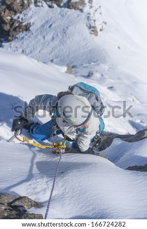 Girl climb up on the ice at glacier