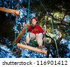 Girl climbing in adventure park - stock photo